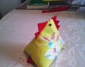 yellow chicken pin cushion.