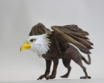 Griffin,fantastic creature,a figure of a Gryphon,Gryphon figurine,sculpture of a Griffin,myth, magical creature,fabulous