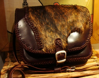 calf leather bag with hair cow on the cover and inside pocket... calf leather handbag with cow hair on the cover and inside pock
