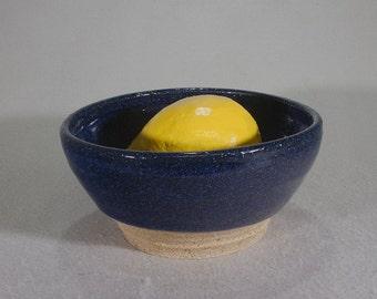 Life Lemon in a Blue Bowl, Stoneware lemon permanently mounted in a blue stoneware bowl.