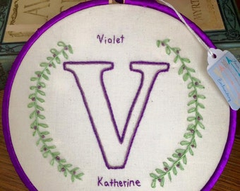 Custom hand-embroidered baby girl nursery monogram hoop art
