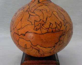 Decorative bottle gourd accented with pyrographic technique and topped with a custom-turned stopper.