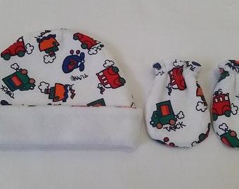 newborn baby boy reversible hat and mittens.
