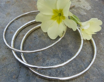 A selction of  hand forged, textured, hammered sterling silver bangles