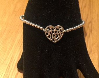 Sterling Silver Small Bead Bracelet with patterned heart charm