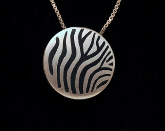 Pendant hangs from a delicate sterling silver chain marked Italy 925 Eight inches long. #228