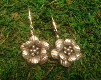 Spring flowers bloom in sterling silver