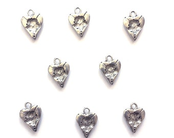 8 Vintage silver tone heart charms jewelry findings. Great for necklace, bracelet, or crafting.