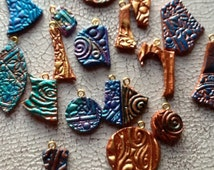 Charms hand tooled hand painted leather 20 total