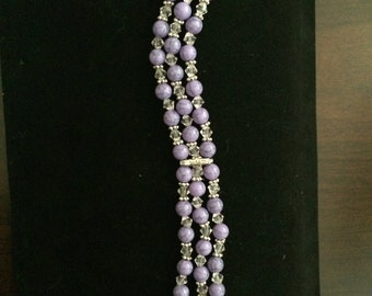 Multi strand pearl and bicone bracelet