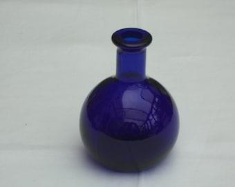 A very attractive  pair of Cobalt blue bottles. Bristol Blue.