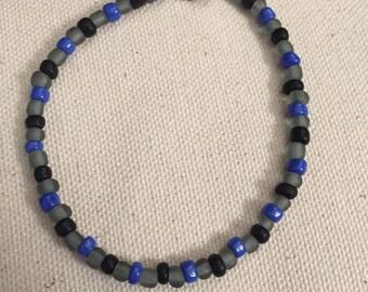 Blue, black, and gray beaded bracelet