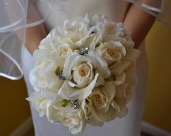 Ivory bridal bouquets/ wedding flowers/gemstones/brooch/roses /ivory