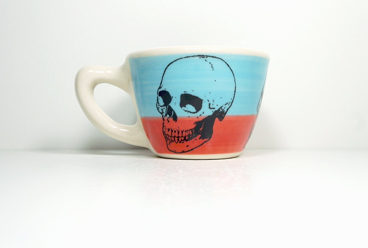 12oz cup that has a badass skull on it, in colour block of sky blue/red-orange, made to order.