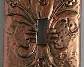 Antiqued Copper  Fleur De Lis  Single toggle switch plate