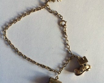 Vintage 9ct English Charm Bracelet with Shoe, Fortune Teller, and Arc charm all open