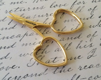 small GOLD colored embroidery scissors with heart shaped handles little love for cross stitch