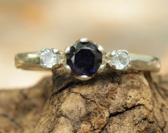 Labradorite ring with side set aquamarine gems in silver band