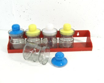Vintage set of wall hanging storage jars, red yellow and blue small bottles for organization