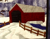 Wall hanging fiber art quilted landscape snow scene and covered bridge