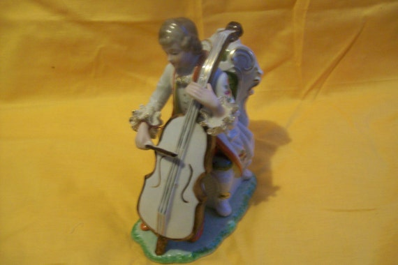 A victorian man playing an instrument, the cello,  vintage,  1950's, collectible, porcelain, porcelain lace, gift, vintage gift