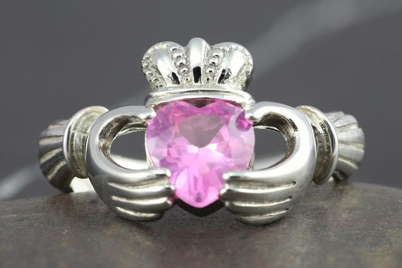 Sterling silver Claddagh ring with a pink sapphire