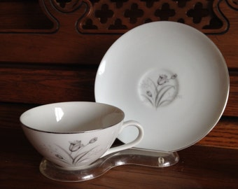 Gray and White Floral Teacup and Saucer