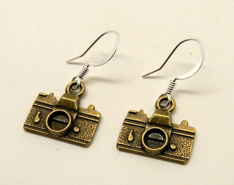 Steampunk camera earrings.