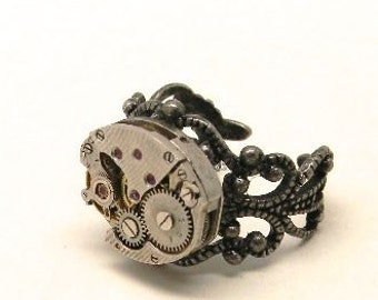 Steampunk ring with vintage watch. Steampunk jewelry.