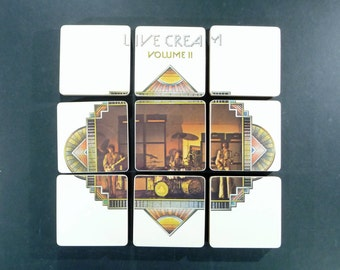 Cream handmade wood coasters created from recycled Live Cream Volume II record album cover with warped vinyl bowl
