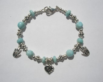 """Heart in Hands Bracelet - AA Natural Larimar and Sterling Silver-  7 3/4"""" - 1"""