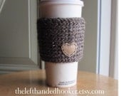 Knitted travel mug cozy take out cup sleeve with tan hanging heart in barley brown