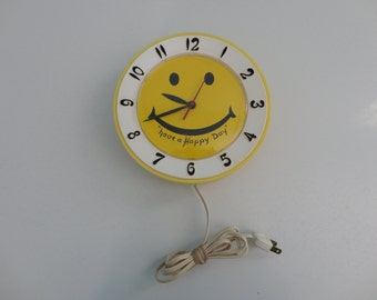 VINTAGE yellow smiley face LUX electric wall CLOCK