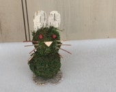 Bunny rabbit made from moss and birch bark, for a rustic nature lover's home.