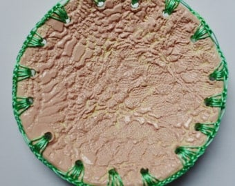 Ceramic plate in baby pink with greeen crochet detail