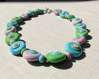 spring lampwork necklace in pastel pink, turquoise, and green.  Sterling silver clasp.  Flat beads with stacked, flattened dots.