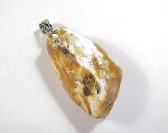 Pendant, handmade of a Baltic amber. EK194