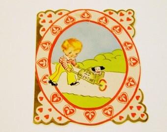 Vintage Art Deco Valentines Card: 1930s Blonde Boy Pushing Puppy Dog in Wheelbarrow, w/ Envelope