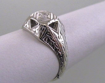 A White Gold and Diamond, Fancy Engraved Square Top Ring, Circa 1930.  (A1632)