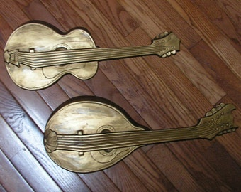 "Vintage Hoda metal wall hangings 1968 Guitar and Mandolin 21"" by 8 1/4"" and 20"" by 8 1/4"""