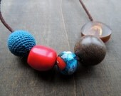 Long necklace in brown red and blue with crochet details