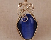 Pendant, Bright blue catseye , sterling silver wire wrap - P137