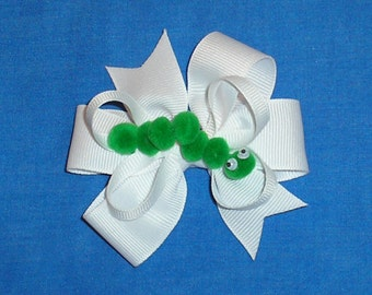 White Bow with caterpillar with moving eyes.  Ready to Ship.