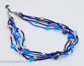 True Blue Necklace, blue bead necklace with yellow and green highlights