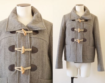 Woolen light grey duffle coat | 1990's by cubesvintage | medium