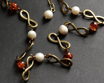 Infinity Necklace. Baltic Amber and Pearl Necklace. Bronze Necklace. Infinity Chain Necklace in Amber. Pearl Necklace. Handmade Necklace.