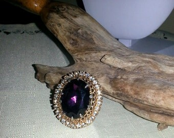 Vintage Brooch gold color victorian style large purple righstone gorgeous piece.