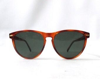 vintage 1980's NOS tortoise shell cat eye sunglasses plastic frames round black lenses fashion accessories eyewear womens sun glasses retro
