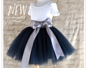 Lined Girl's Tutu sewn in your choice of colors. Navy blue and silver shown.