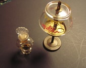 vintage perfume holder with glass shade and small Avon bottle (somewhere) cologne